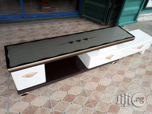 Unique Strong Adjustable T V Stand Glass Top Brand New | Furniture for sale in Lagos State, Lekki