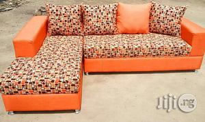L-Shape Sofas / Chairs With Pillows. Orange Colour Fabric   Furniture for sale in Lagos State, Alimosho