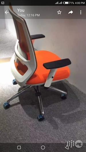 Orange Mesh Swivel Chair | Furniture for sale in Lagos State, Victoria Island