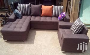 L-Shaped Sofa and a Single Seater Chair With Free Throw Pillows. Brown | Furniture for sale in Lagos State, Ikeja