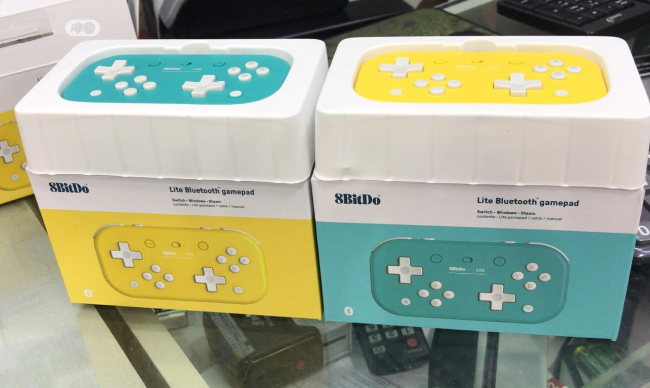 Nintendo Switch Lite- Yellow, Torquitose & Grey