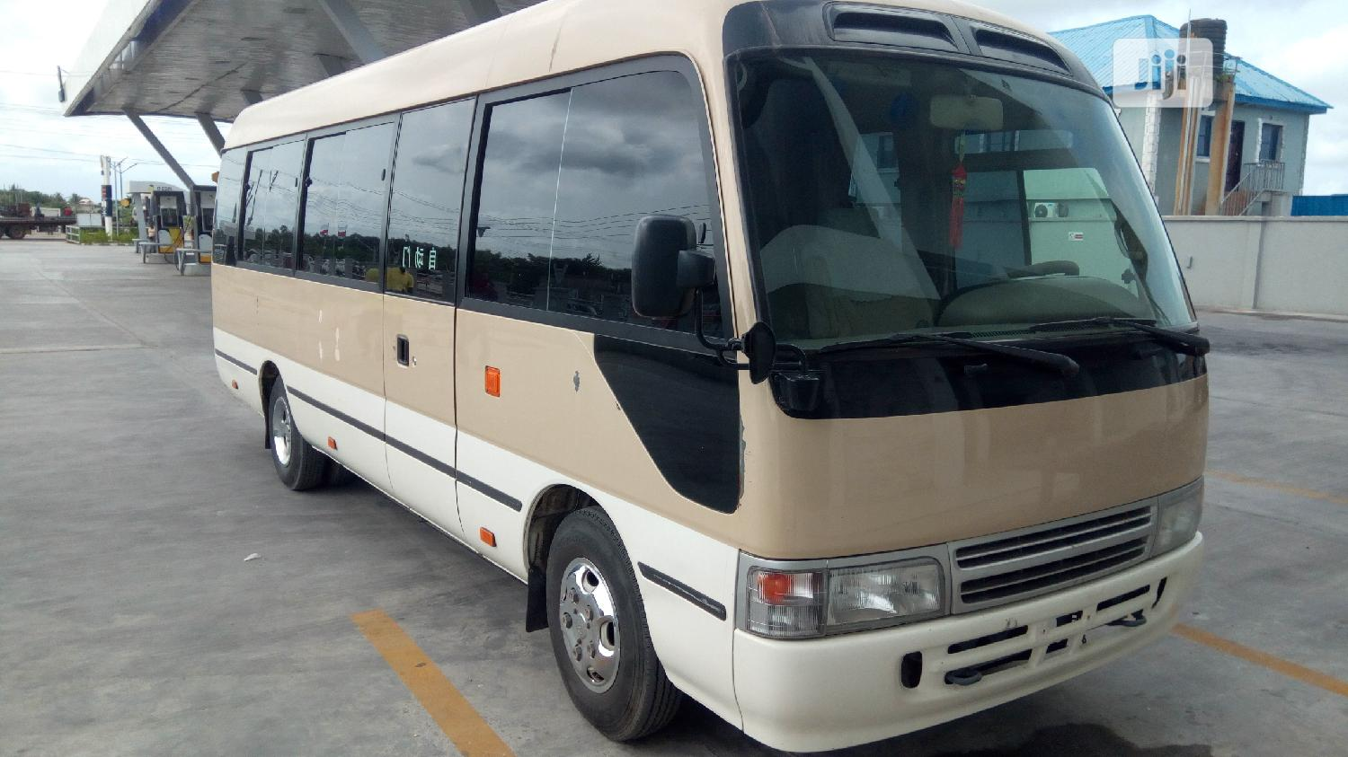 Tokunbo Toyota Coaster 2010 Brown | Buses & Microbuses for sale in Alimosho, Lagos State, Nigeria