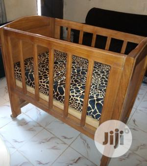 Used Polished Wood Baby Cot | Children's Furniture for sale in Abuja (FCT) State, Gwagwalada