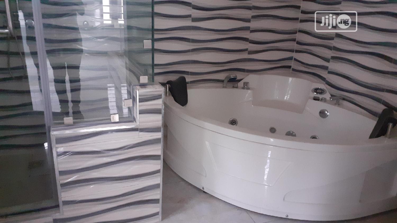 Brown New 5 BEDROOM DUPLEX With A Bq Inside Ikota Villa Estate