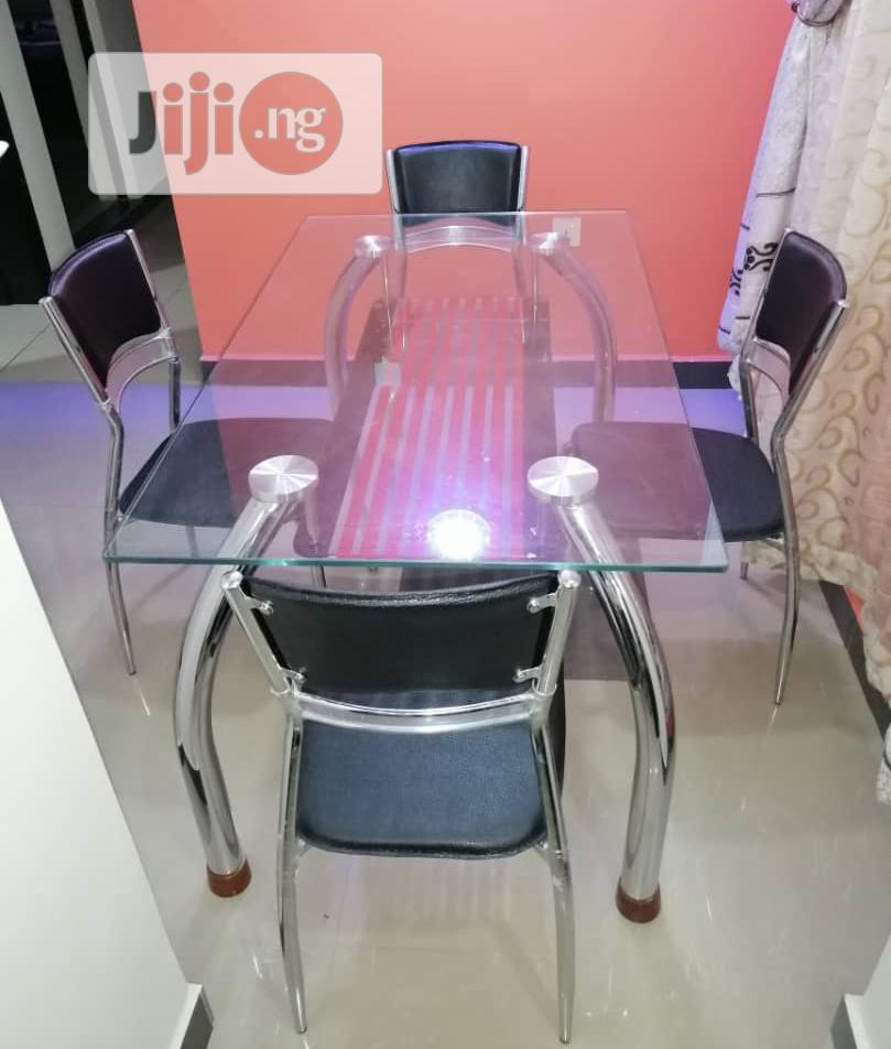 Archive: Good Quality Glass Dinning Table With 4 Chairs.