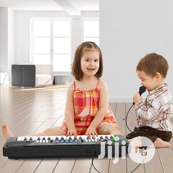 Archive: Kids Electronics Musical Keyboard With Radio & Microphone