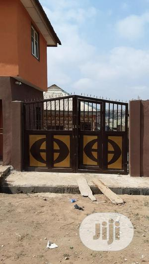 9 Self Contains Room And A Shop At Osere Oke Lambe Matogun | Commercial Property For Sale for sale in Ogun State, Ifo