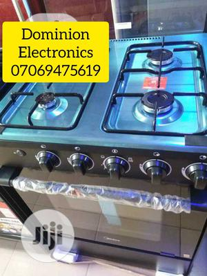 Original Midea Standing Gas Cooker 4burners With Oven 50×50 | Kitchen Appliances for sale in Lagos State, Ojo
