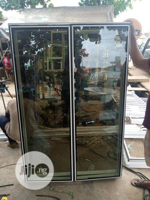 Frameless Window With Burglary And Net | Windows for sale in Lagos State, Agege