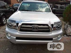 Toyota Tacoma 2010 Double Cab V6 Automatic Silver | Cars for sale in Lagos State, Surulere