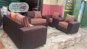 7 Seater Brown and Orange Stripe Sofa   Furniture for sale in Lagos State, Ojo