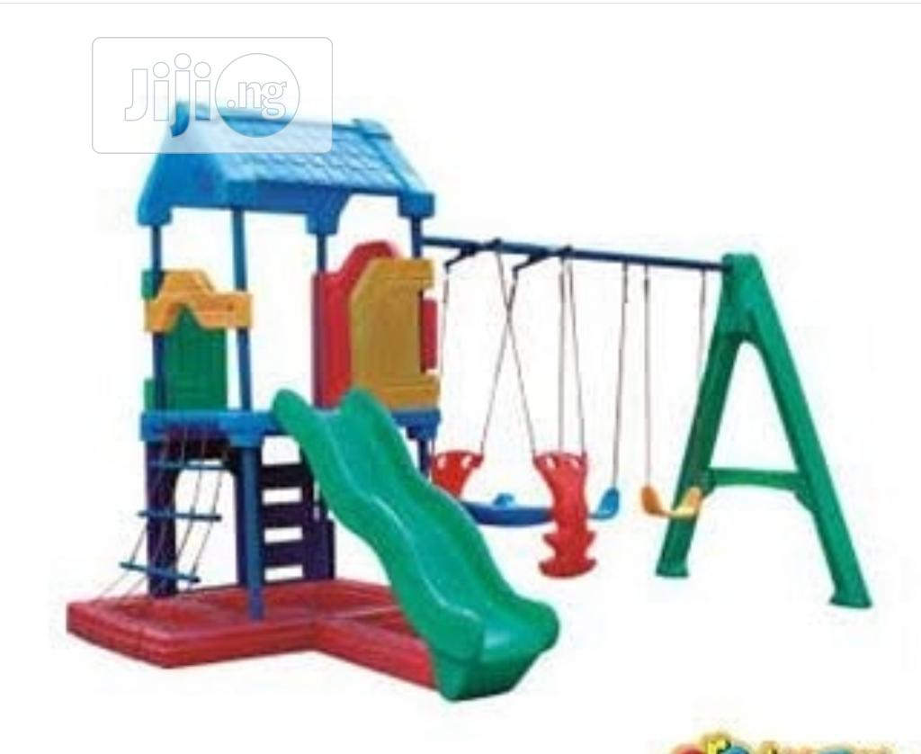 Playground Equipment With Swing and Glider