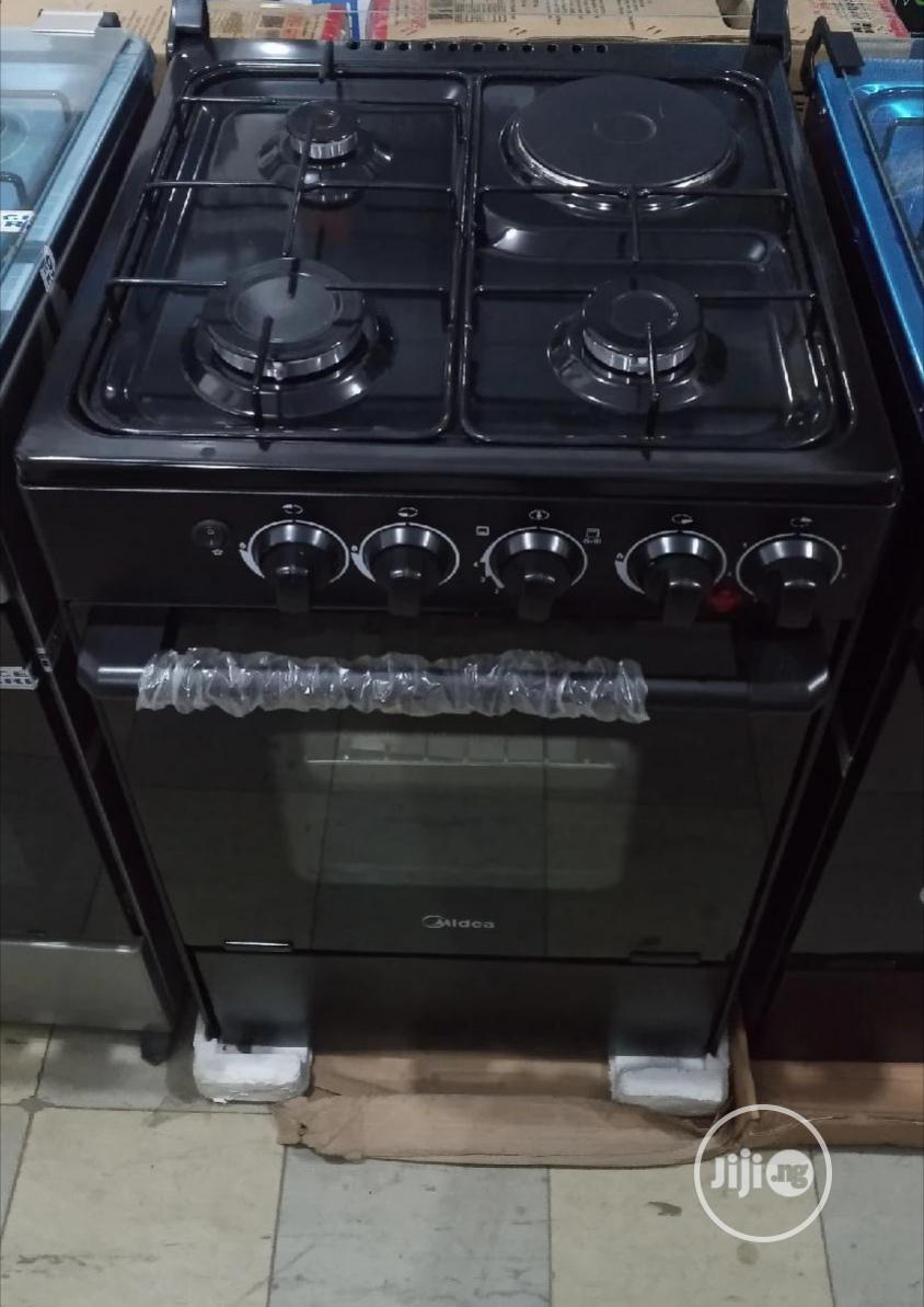 Archive: Midea Gas Cooker With Oven, 3 Burners 1 Hot Plate. 50x55