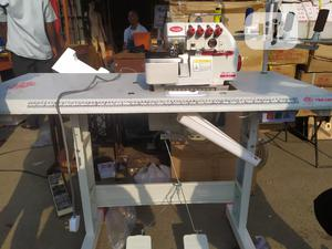 TWO LION 3thread Industrial Weaving/Overlock Machine   Manufacturing Equipment for sale in Lagos State, Mushin