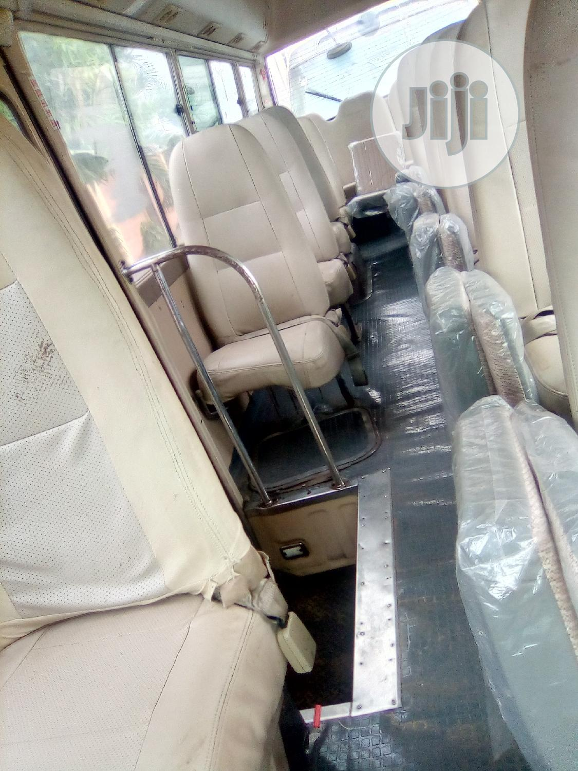 Toyota Coaster 2009 Beige | Buses & Microbuses for sale in Ikeja, Lagos State, Nigeria