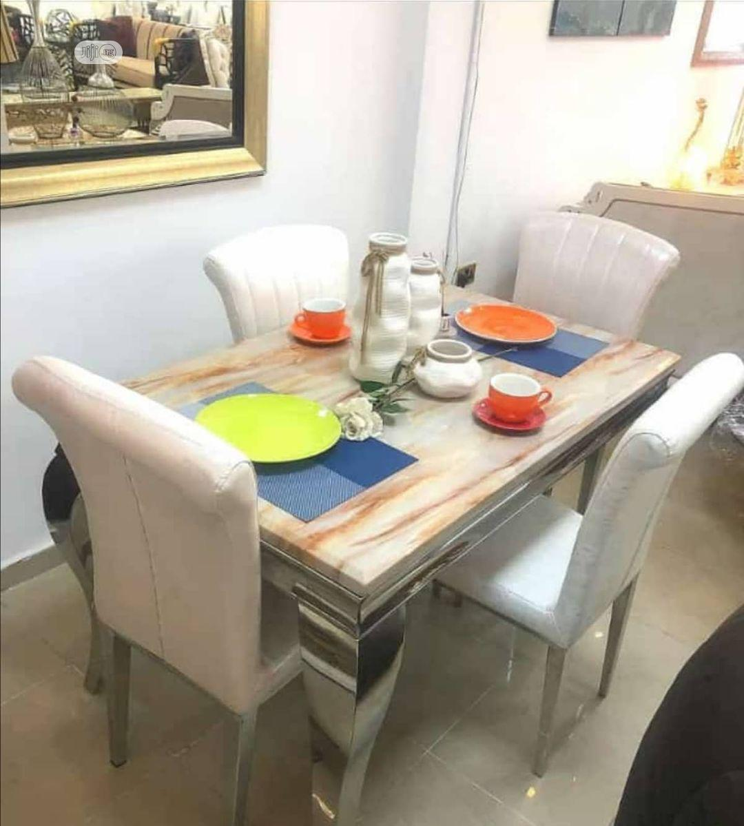 Classy Marble Dinning Table by 4 Chairs.