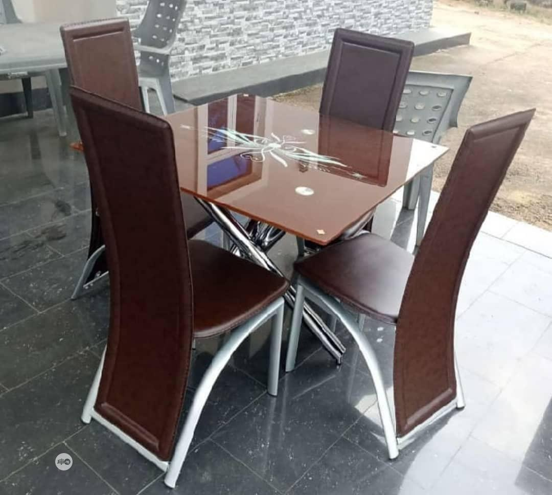 Glass Dinning Table by 4 Chairs