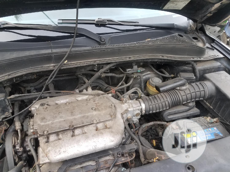 Archive: Honda Pilot 2004 EX 4x4 (3.5L 6cyl 5A) Black