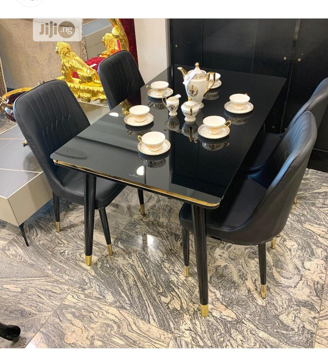 Quality Glass Dinning Table With 4 Chairs