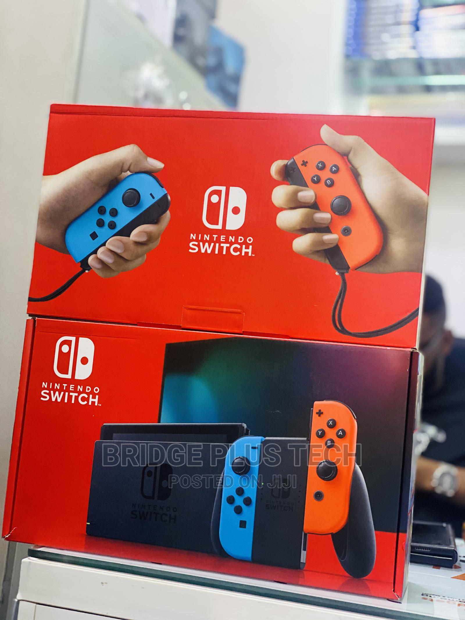 Archive: Nintendo Switch With Neon Blue And Red Controller