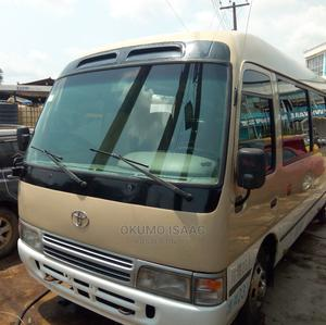 Tokunbo Toyota Coaster 2010 Brown | Buses & Microbuses for sale in Lagos State, Alimosho