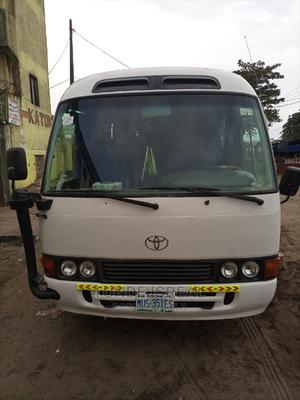 Toyota Coaster 2013 White for Sale | Buses & Microbuses for sale in Lagos State, Alimosho