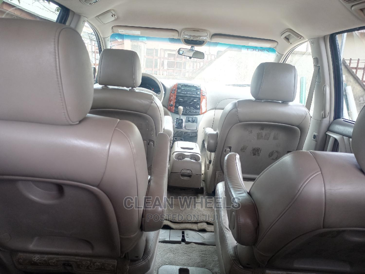 Archive: Toyota Sienna 2006 XLE Limited AWD Red