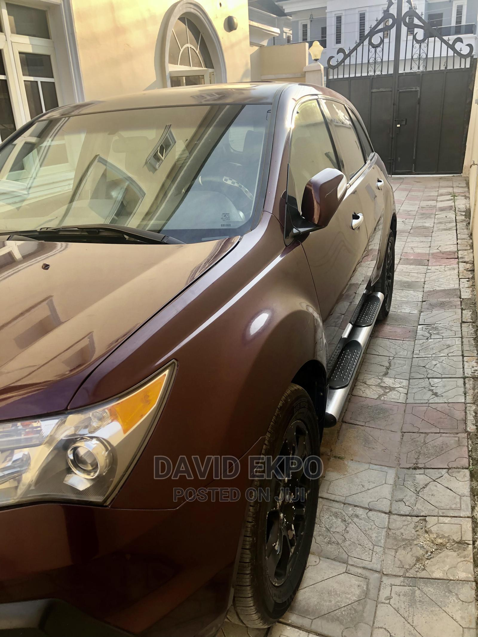 Archive: Acura MDX 2007 SUV 4dr AWD (3.7 6cyl 5A) Red
