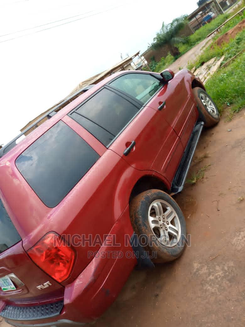 Archive: Honda Pilot 2006 EX 4x4 (3.5L 6cyl 5A) Red