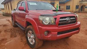 Toyota Tacoma 2009 Double Cab V6 Automatic Red | Cars for sale in Ogun State, Ado-Odo/Ota