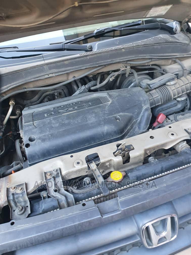 Archive: Honda Pilot 2004 LX 4x4 (3.5L 6cyl 5A) Brown
