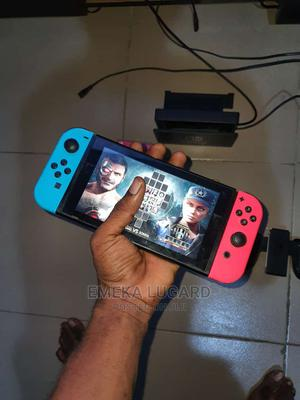 Neathly Used Nintendo Switch With MK11 Caset for Sale | Video Game Consoles for sale in Edo State, Benin City