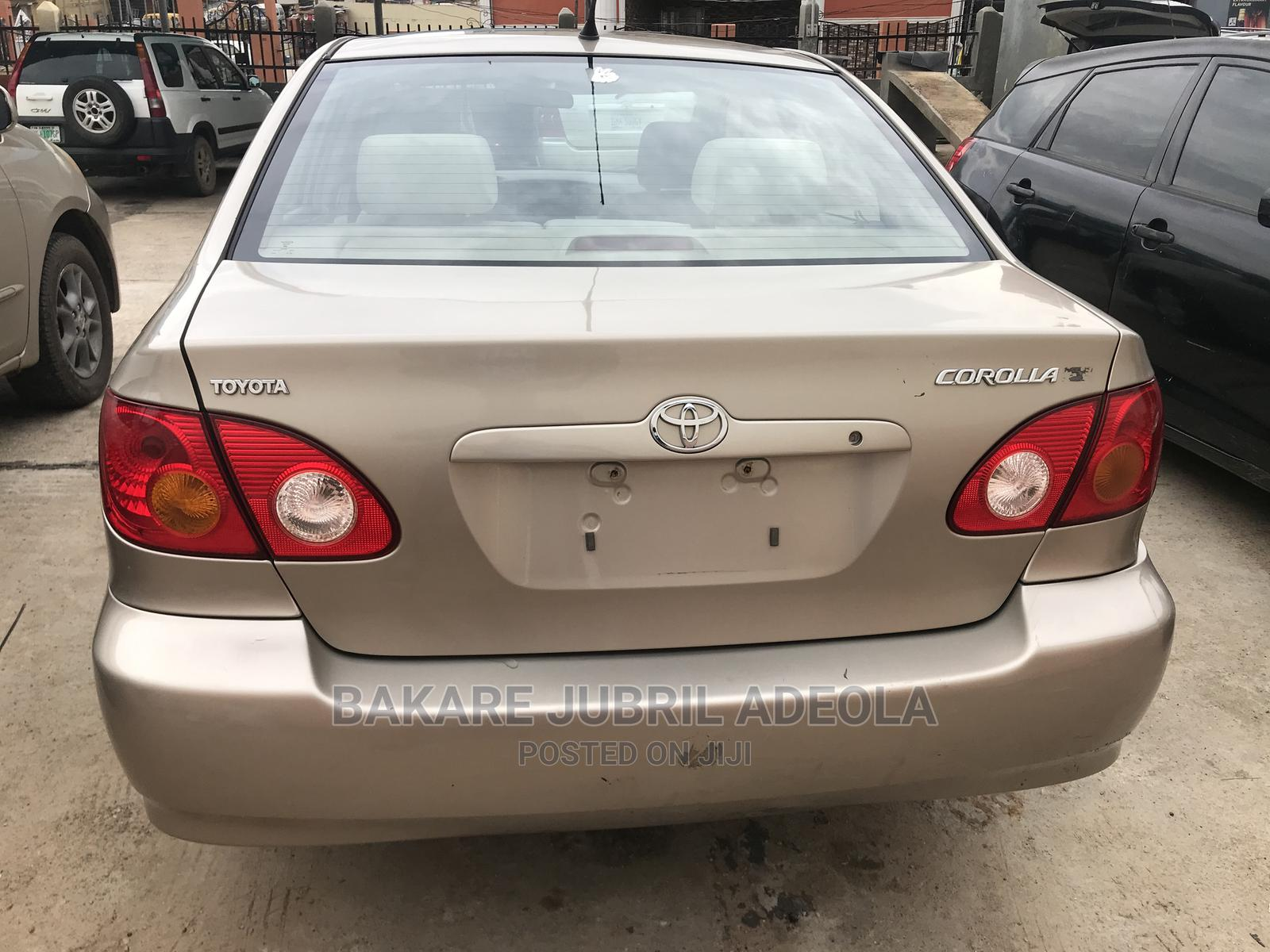 Archive: Toyota Corolla 2004 Sedan Automatic Gold