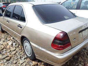 Mercedes-Benz C230 2003 Gold | Cars for sale in Abuja (FCT) State, Katampe