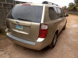 Kia Sedona 2007 2.5l Automatic Gold | Cars for sale in Ogun State, Ado-Odo/Ota