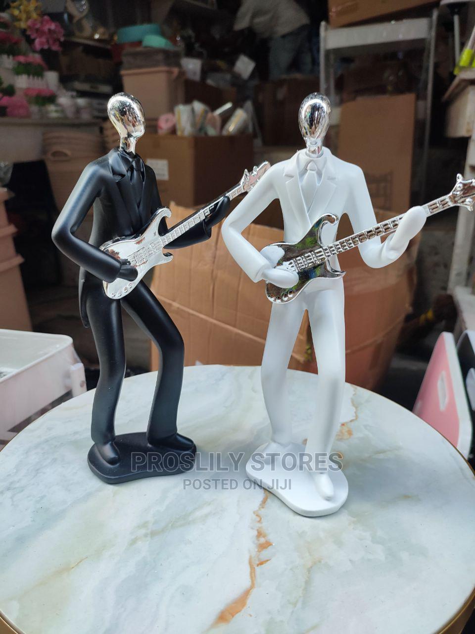 Guitar Man Figurine . Matl: Ceramic . Colours White, Black