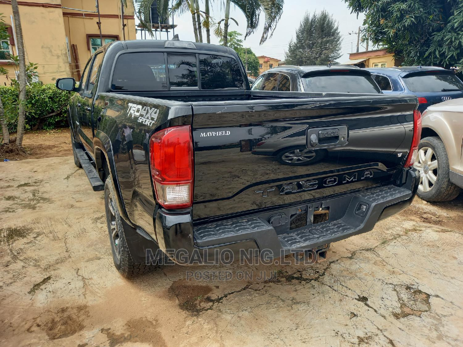 Toyota Tacoma 2016 4dr Double Cab Black | Cars for sale in Ikeja, Lagos State, Nigeria