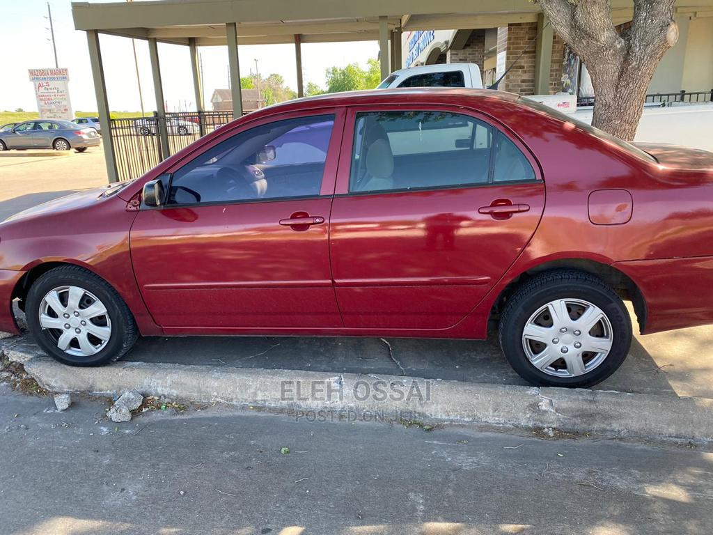 Archive: Toyota Corolla 2005 LE Red
