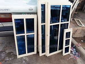 Sliding Windows With Blue Reflective Glass. | Windows for sale in Oyo State, Ibadan