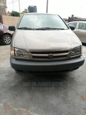 Toyota Sienna 1999 LE 4dr Brown | Cars for sale in Lagos State, Ikeja