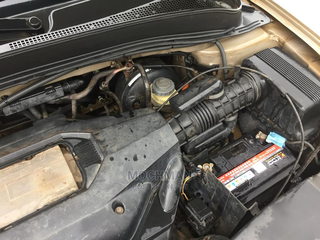 Archive: Honda Pilot 2004 EX 4x4 (3.5L 6cyl 5A) Gold