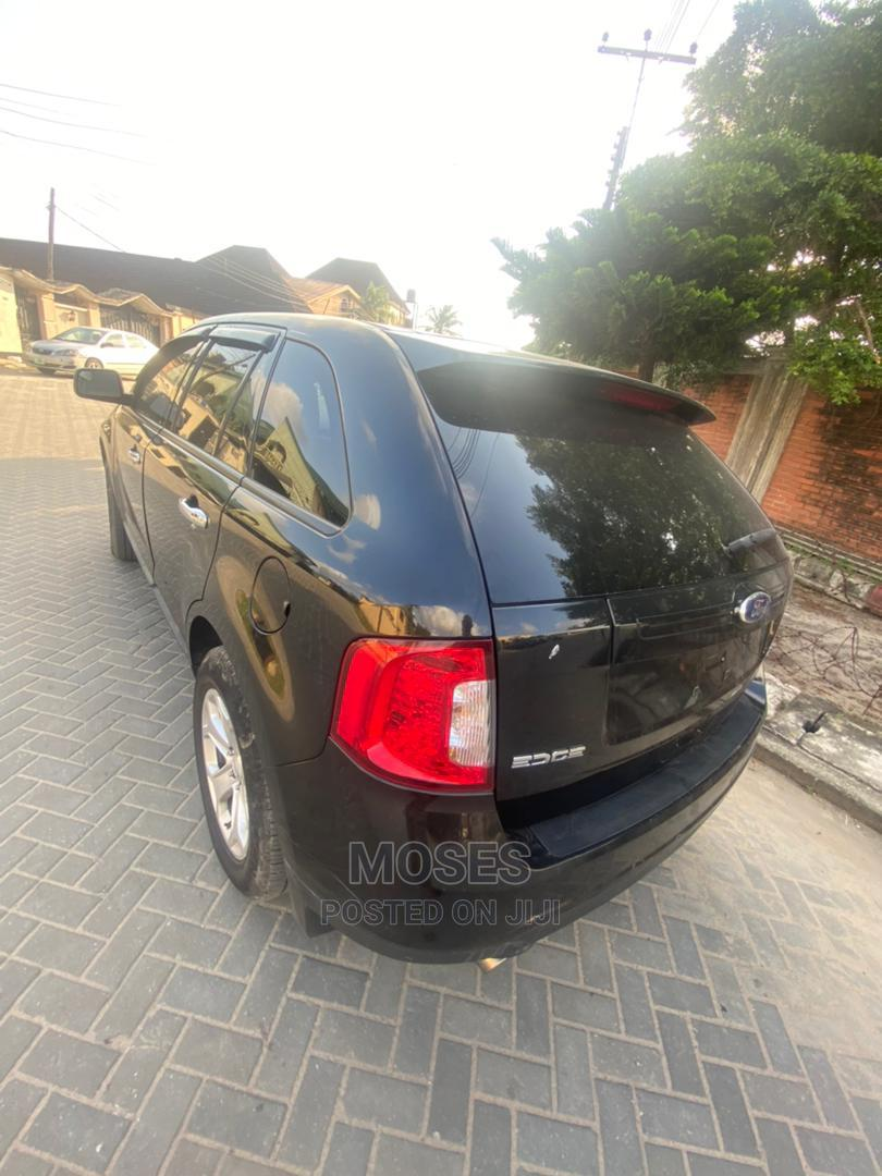 Archive: Ford Edge 2011 SE 4dr FWD (3.5L 6cyl 6A) Black