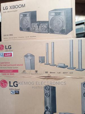 LG Home Theater 1000 Watts With Bluetooth   Audio & Music Equipment for sale in Lagos State, Ojo