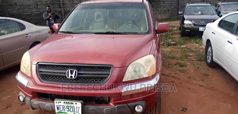 Archive: Honda Pilot 2004 LX 4x4 (3.5L 6cyl 5A) Red
