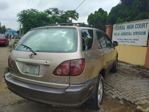 Lexus RX 2000 300 2WD Gold   Cars for sale in Lagos State, Ikeja