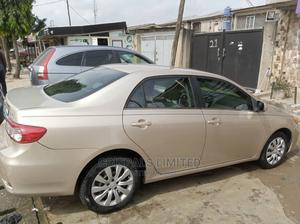 Toyota Corolla 2013 Gold | Cars for sale in Lagos State, Ikeja