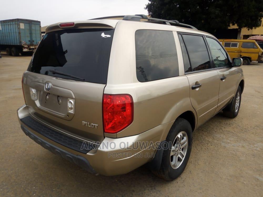 Archive: Honda Pilot 2005 LX 4x4 (3.5L 6cyl 5A) Gold