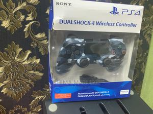 SONY Ps4 Dualshock 4 Wireless Controller - Blue Camouflage   Video Game Consoles for sale in Lagos State, Ikeja