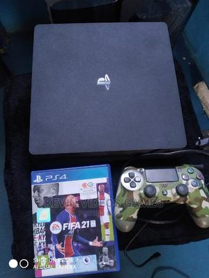 Clean as New Ps4 Slim+Fifa21 | Video Game Consoles for sale in Edo State, Benin City