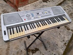 Perfectly Working Original 5ocatves Keyboard With Adapter   Musical Instruments & Gear for sale in Lagos State, Ipaja
